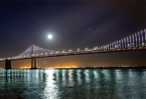 Golden Gate Bridge bathed in moonlight