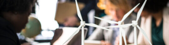 Windmill models on a meeting table