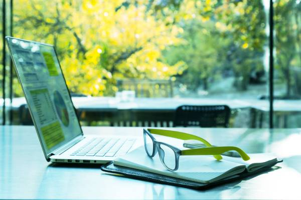 Laptop and glasses on desk